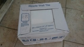 3x boxes of white tiles in Lakenheath, UK