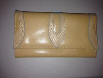 Emilie M. Tan leather and snake print wallet in Fort Bliss, Texas