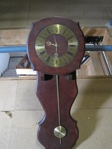 Old wall mounted pendulum clock in Baumholder, GE