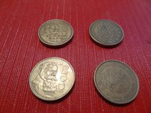 four  100 Mexican Peso coins in Spring, Texas