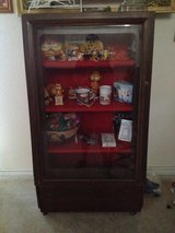 Rolling display case 2 ft 4 in across back 4 ft 2 in height 1.5 width at bottom in Baytown, Texas
