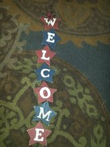 red white & blue Welcome sign in Chicago, Illinois