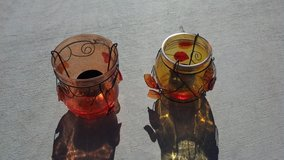 Glass decorative candle holders in 29 Palms, California