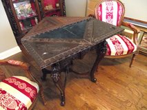 Oriental heavily carved antique game table in Moody AFB, Georgia