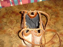 Small woven handbag with leather trim in Camp Lejeune, North Carolina