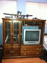 SOLID WOOD ENTERTAINMENT CENTER in Kingwood, Texas