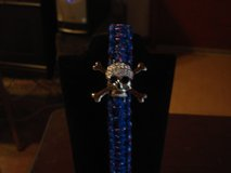 BLUE PARACORD BRACELET WITH CRYSTAL SKULL AND CROSSBONES in Barstow, California