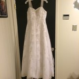 REDUCED David's Bridal Wedding Gown & Veil cost over $900 new in Liberty, Texas