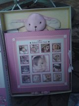 Baby's first year photo album with growth chart for wall in Leesville, Louisiana