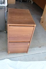 Brown Wood filing cabinet (on wheels) in 29 Palms, California