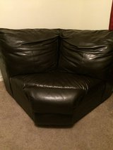 Dark brown leather corner of a sectional in Montgomery, Alabama