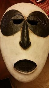 Closed Mouth Wood Mask Wall Hanging in Fort Campbell, Kentucky
