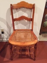 Vintage Maple chair with cane seat in Joliet, Illinois