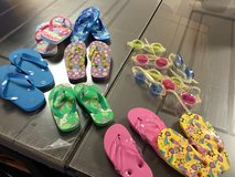 Assorted unused kids flip flops and goggles in Alamogordo, New Mexico