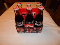 Collectible Coke Bottles Lot of 4 in Fort Campbell, Kentucky