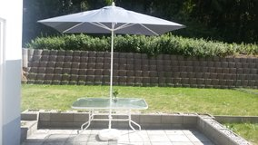 Table and Umbrella Patio Set in Ramstein, Germany