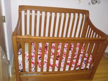 Simmons wooden baby crib +matching changing table+ mattress if wanted in Oswego, Illinois
