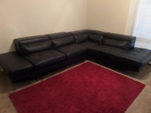 black sectional with zebra chair in Louisville, Kentucky