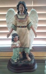 Indian Angel w/t Child Holding Dove in Conroe, Texas