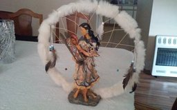 Indian Lady Holding Baby Dream Catcher in Conroe, Texas