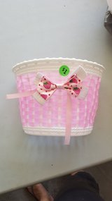 Pink bike basket in Lockport, Illinois
