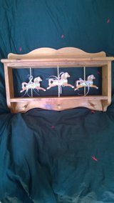 Shelf with Carousel Horses in Aurora, Illinois