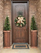 Christmas tree stands porch flower pot in Camp Lejeune, North Carolina