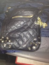 Black w gold leather in Chicago, Illinois