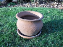 Heavy clay pot and saucer in Aurora, Illinois