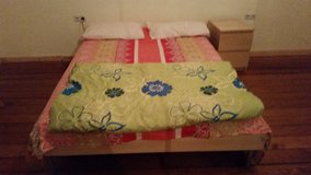 Bed with slatted frame and mattress in New Orleans, Louisiana