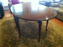 Cherry dining room table, 4 chairs, and protective table pads in Huntsville, Alabama