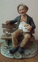 Old Man Feeding Birds on Bench Porcelain Statue in Conroe, Texas