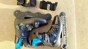 Eclipse nine inch roller blades with wrist guards in Tinley Park, Illinois