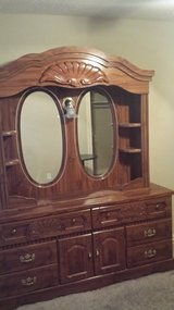 Queen size bedframe with head board foot board long dressor with mirror and tall dressor in Altus, Oklahoma
