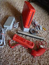 Red Wii console with controller and nunchuck in Warner Robins, Georgia