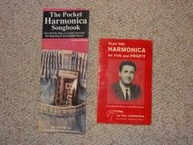 Two books on how to play the Harmonica in Tomball, Texas
