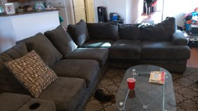 large Ashley furniture sectional less then 1 year old in Fort Bliss, Texas