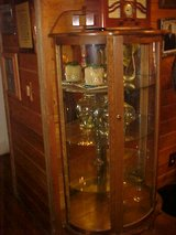 Solid Oak Bow Front Curio Cabinet in Moody AFB, Georgia