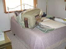 Queen Size Bed with Mattress, box springs and includes good bedding in Huntsville, Texas