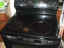 GE electric Glass top self cleaning stove in Fort Campbell, Kentucky