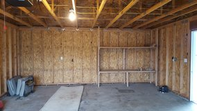 Free wood garage shelving unit. You must disassemble and haul in Fort Lewis, Washington