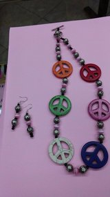 pretty peace sign necklace and earrings in 29 Palms, California