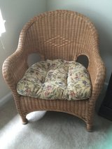 Wicker chair with cushion in Fairfax, Virginia