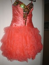 Special occassion or prom dress, beautiful watermelon color with form accentuating design in Cochran, Georgia