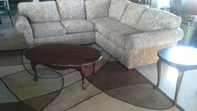 sectional couch, tables, and area rug in Fort Leonard Wood, Missouri