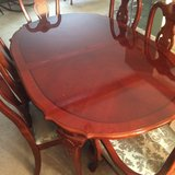 Cherry wood Dining room table and 8 chairs in Fort Carson, Colorado
