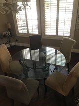Glass dining table and chairs in Houston, Texas