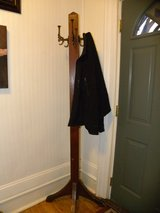 Antique, thick wooden coat tree stand in Salina, Kansas