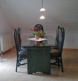 Rattan glass top dinner table with 6 chairs in Ramstein, Germany