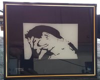 Face Palm painting on glass in Nellis AFB, Nevada